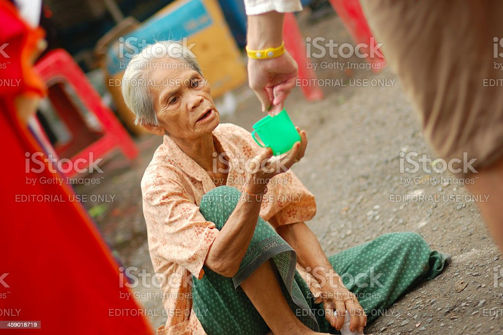 Local woman begging for money on the streets. royalty-free stock photo