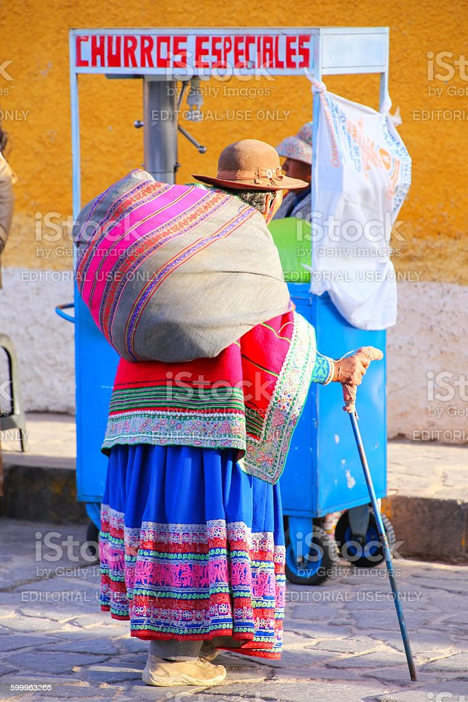 Local woman walking in the street of Chivay town, Peru stock photo