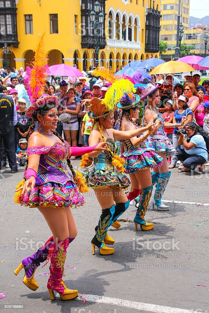 Local women dancing in Lima, Peru stock photo