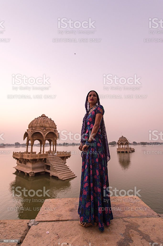 Local women in the Gadi Sagar temple on Gadisar lake. stock photo