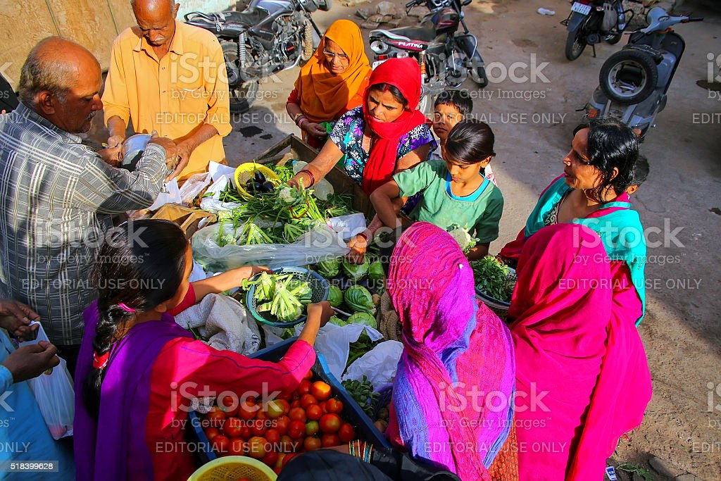 Local women shopping for vegetables at the street market stock photo