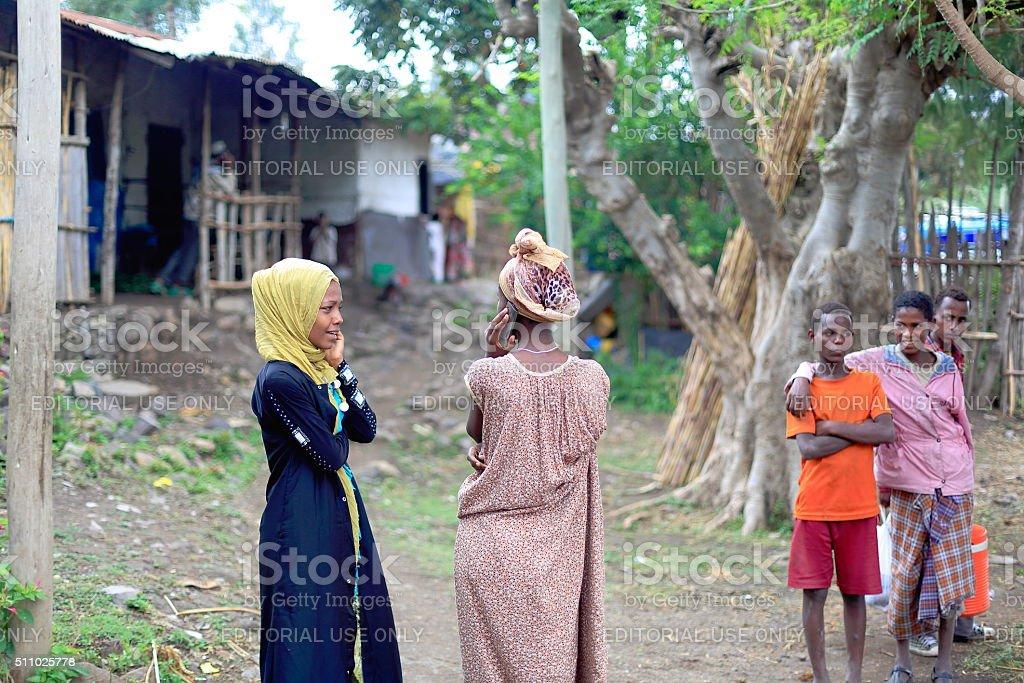 Local young girls speak by phone-khat market. Degan town-Ethiopia. 0113 stock photo