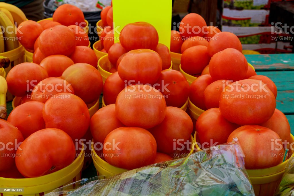 locally grown red tomatoes at local farmers market stock photo