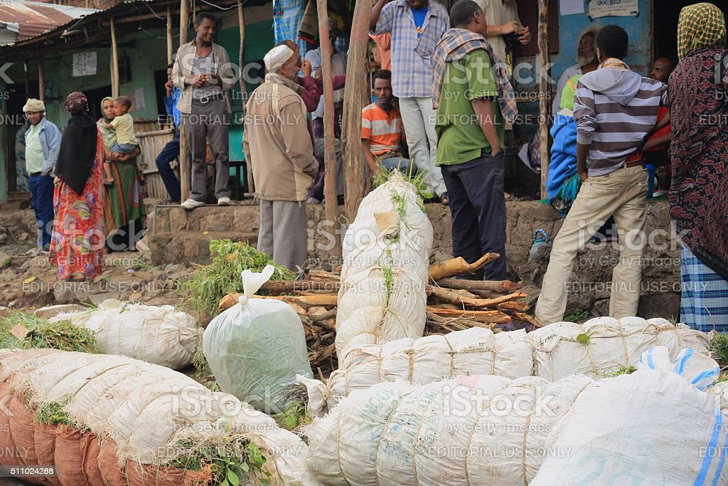 Locals and packs of khat leaves-khat market. Degan town-Ethiopia. 0105 stock photo