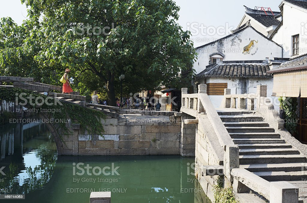 Locals and tourists at the famous Twin Bridge in Zhouzhuang stock photo