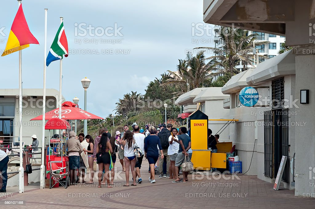 Locals and tourists on the promenade stock photo