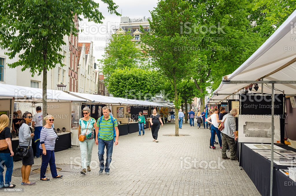 Locals and Tourists visiting a Small Art Market in Amsterdam stock photo