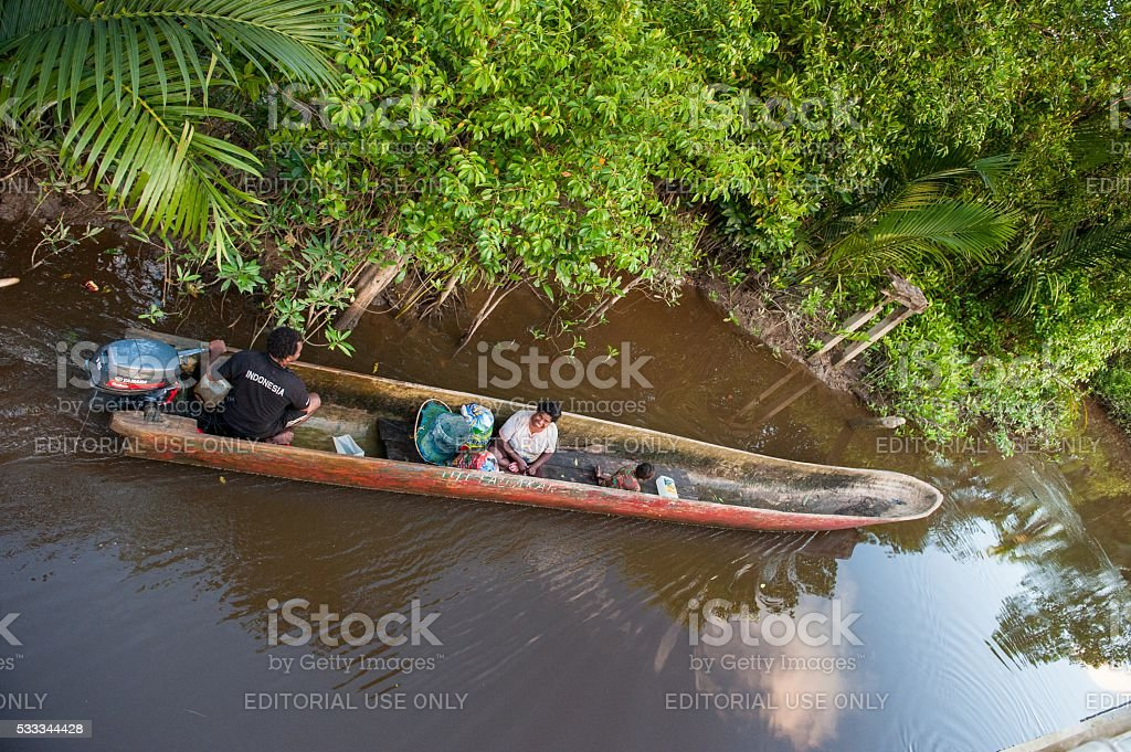 Locals float in the pirogue stock photo