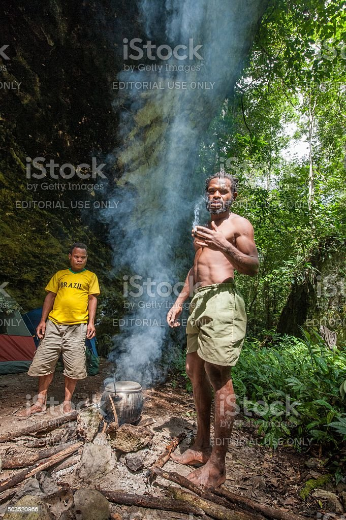 Locals of the island New Guinea have dinner stock photo