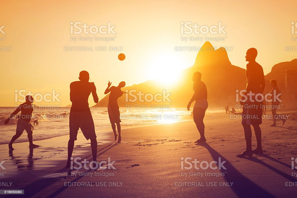 Locals Playing Ball in Ipanema Beach, Rio de Janeiro, Brazil stock photo