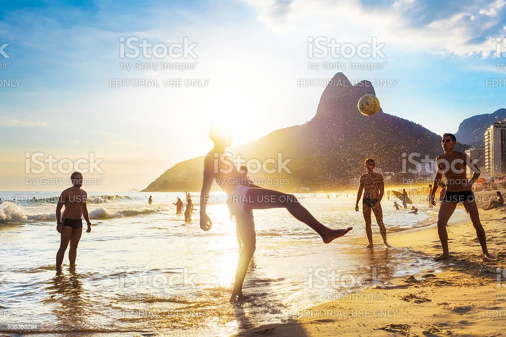 Locals Playing Ball in Ipanema Beach, Rio de Janeiro, Brazil stock photo