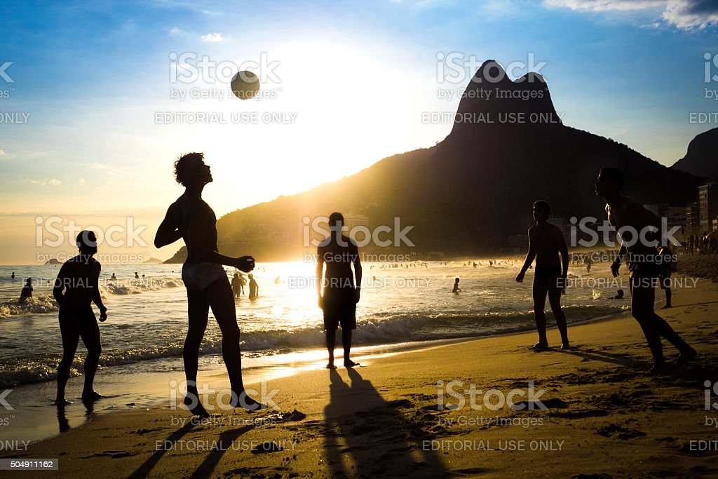 Locals Playing Soccer at Ipanema Beach, Rio de Janeiro, Brazil stock photo