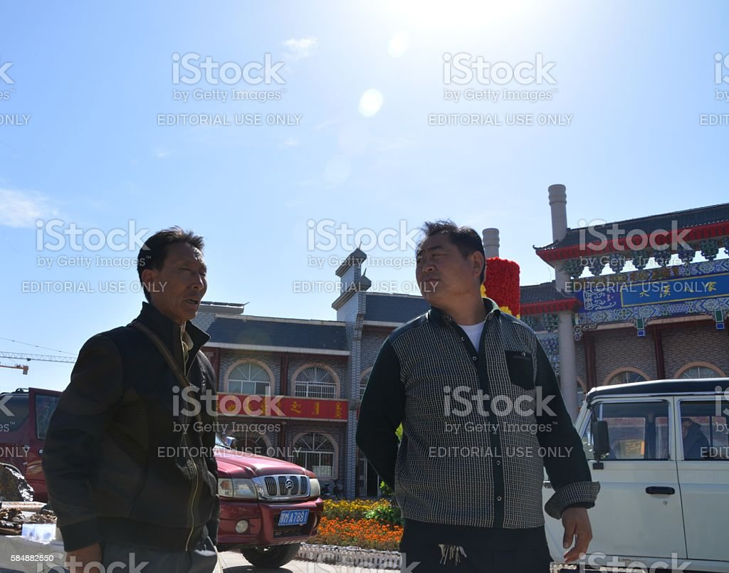 Locals under the sun in Alashan Youqi town, Inner Mongolia stock photo