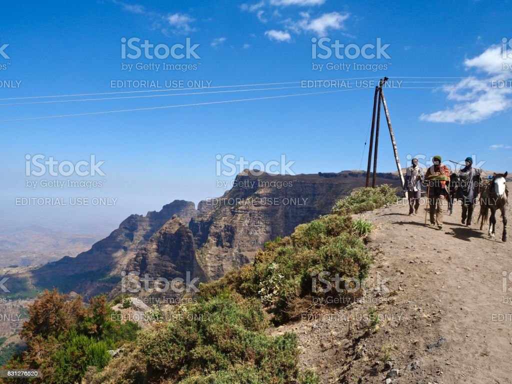 Locals walking in the Simien Mountains stock photo