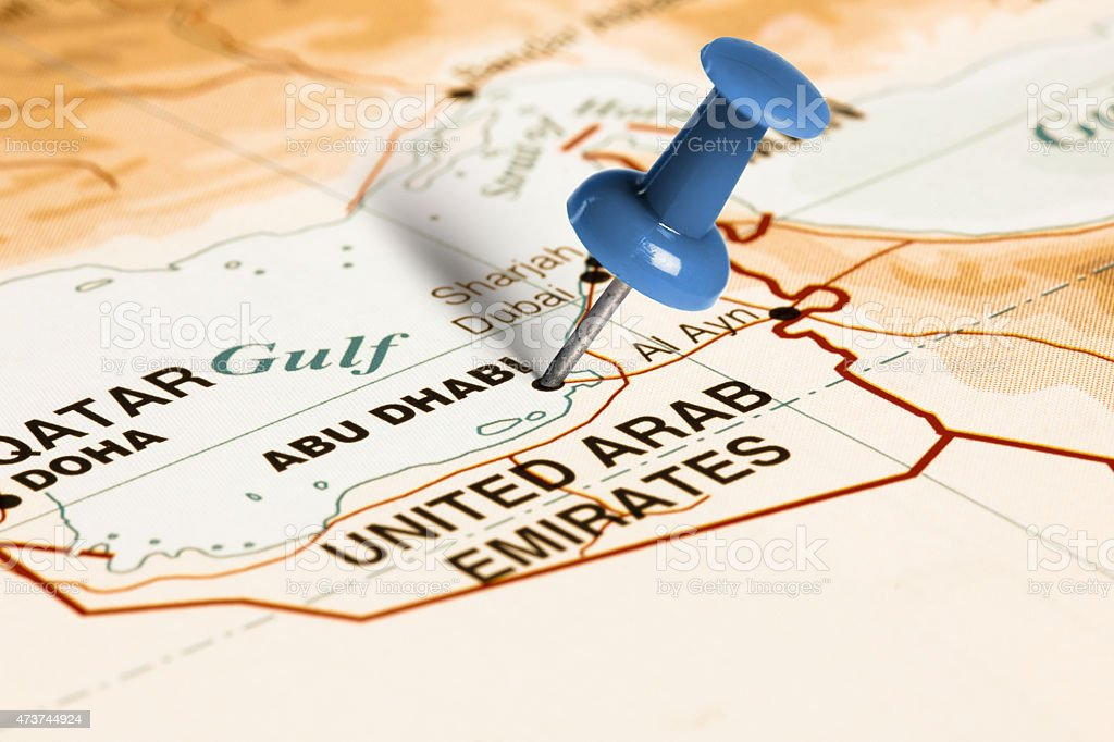 Location Abu Dhabi. Blue pin on the map. stock photo