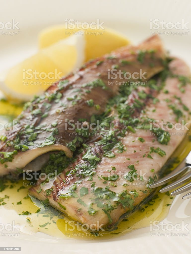 Loch Fyne Kippers Grilled with Parsley Butter royalty-free stock photo