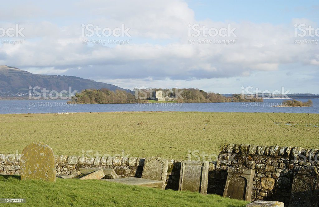Loch Leven castle from Kinross cemetry stock photo