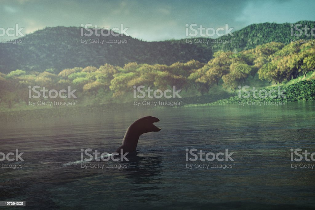 Loch Ness monster swimming in the lake stock photo