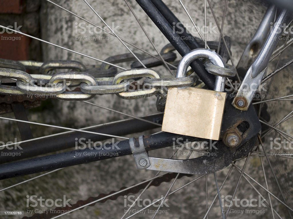 Lock and chain on a bicycle stock photo