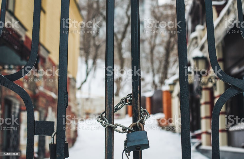 Lock and chain on gates stock photo