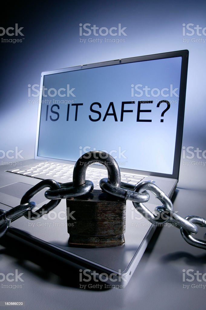 Lock and chain sitting on laptop computer royalty-free stock photo