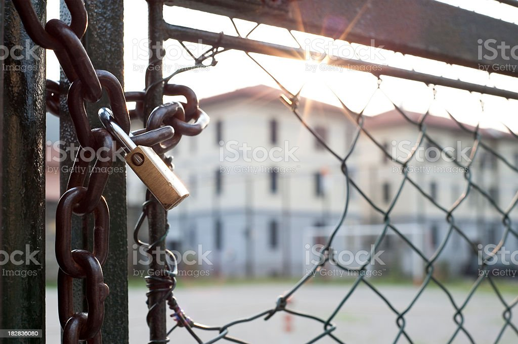 Lock And Hole In The Net Against  Light stock photo
