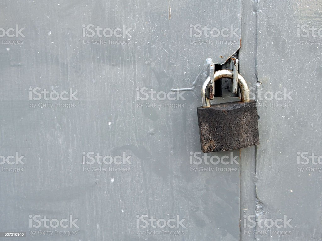lock at a dirty metal door stock photo