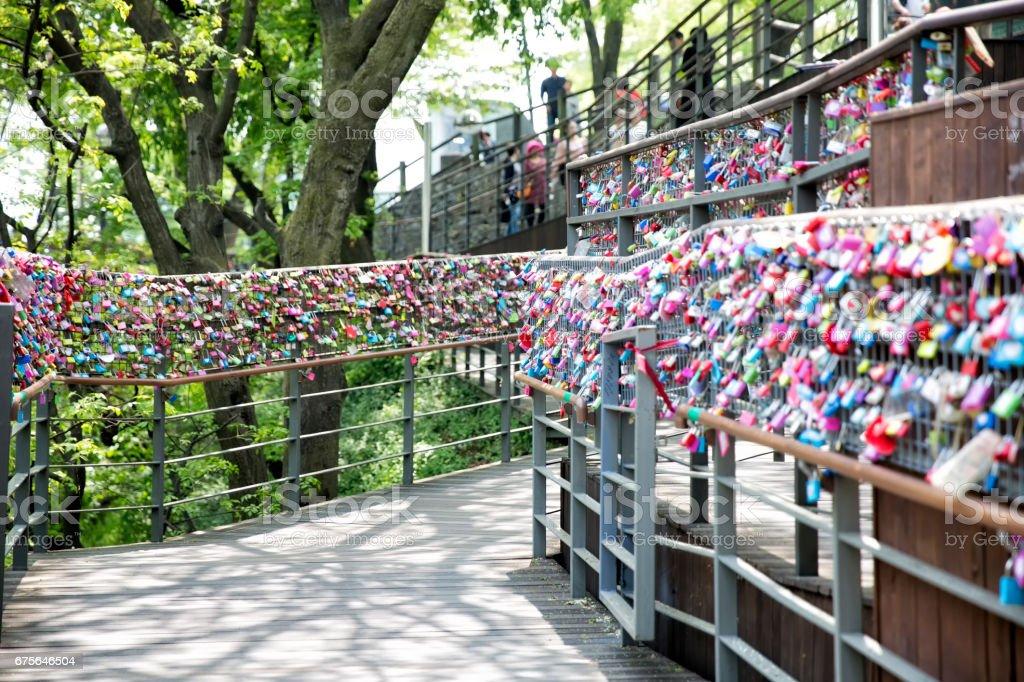 A lock fence pledging love stock photo
