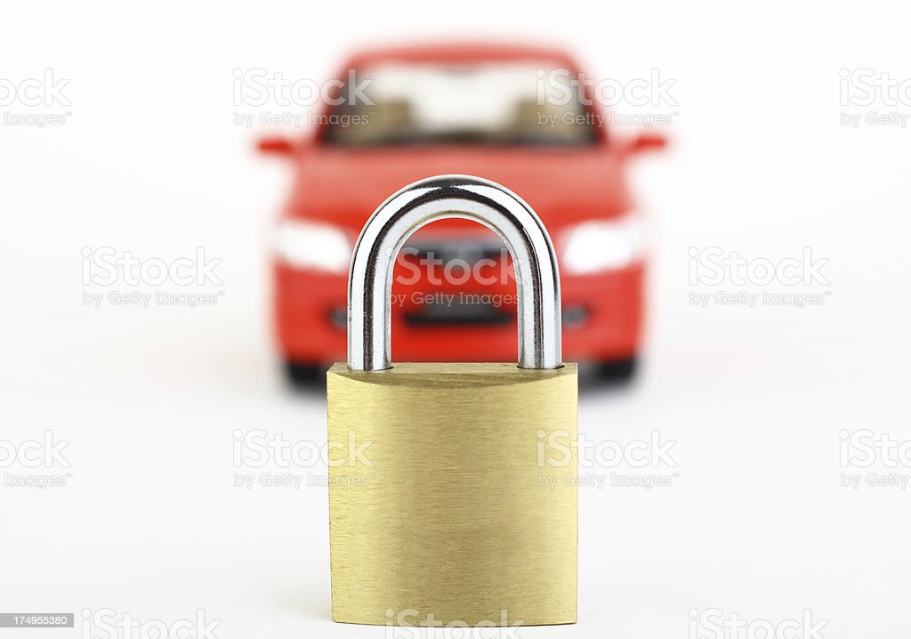 Lock in front of blurred red car stock photo