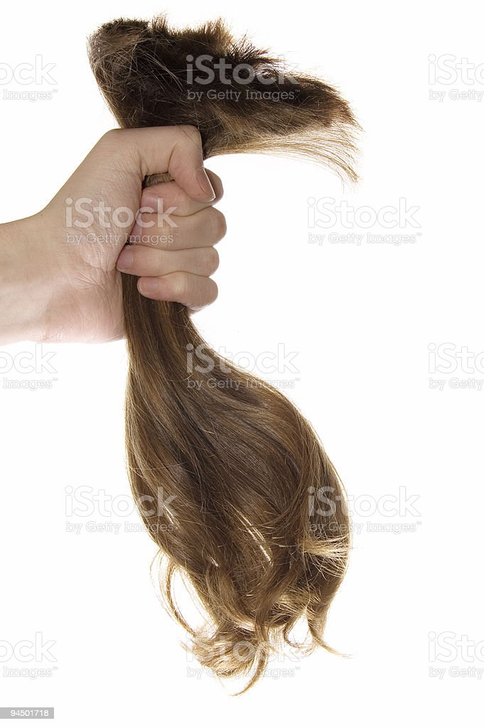 Lock of hair in a hand stock photo