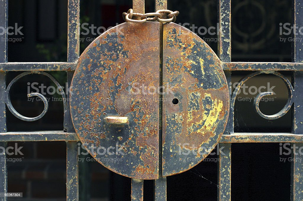 Lock on a metal gate royalty-free stock photo