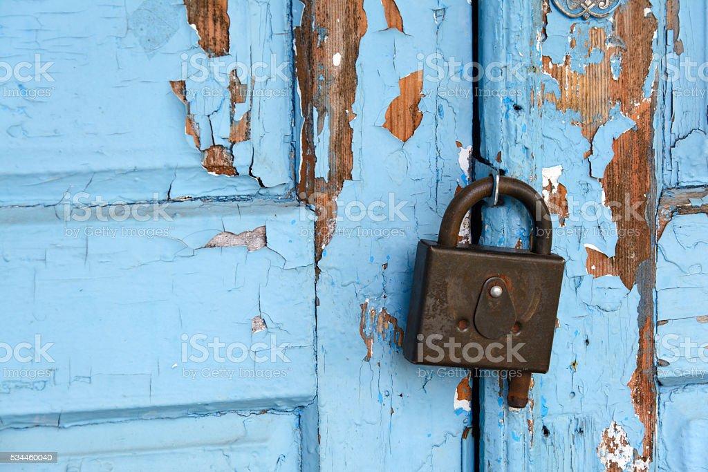 lock on the blue door stock photo