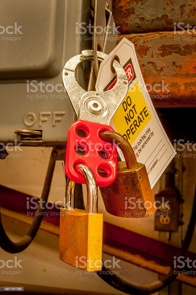 Lock Out Tag Off (LOTO) Tag on Equipment Control Panel stock photo