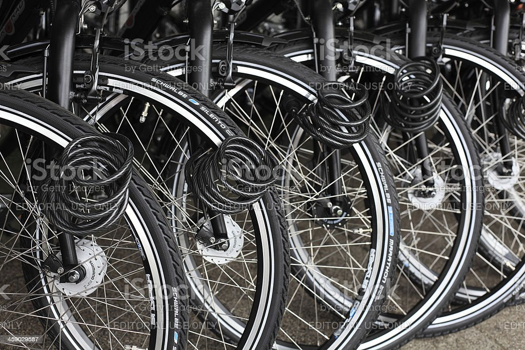 locked bicycles in a row stock photo