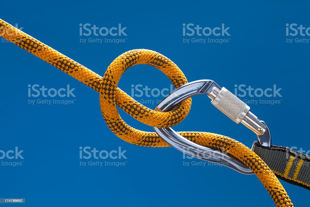 Locked Carabiner on yellow rope royalty-free stock photo