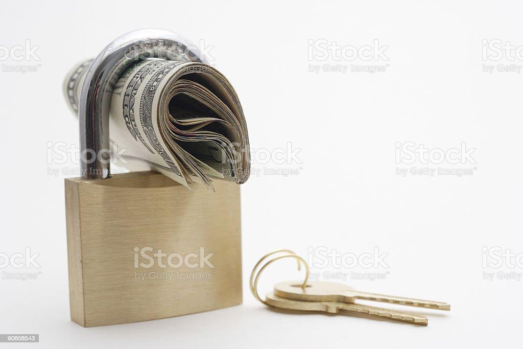 Locked money with keys stock photo
