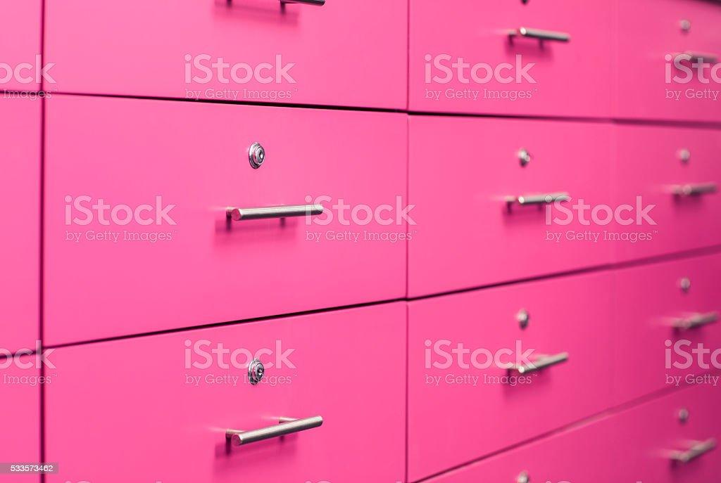 Locked pink drawers. stock photo