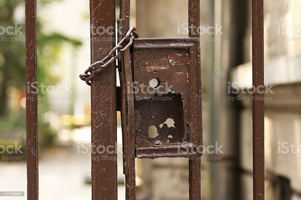 Locked rusty gate royalty-free stock photo