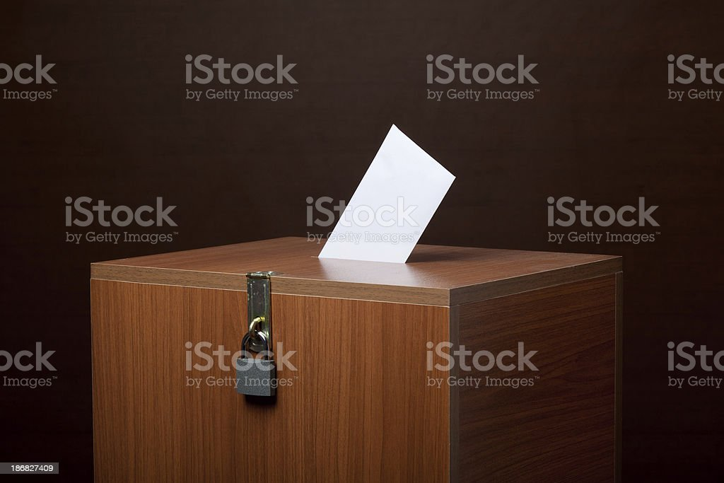 Locked Wooden Ballot Box With A Poll Envelope On stock photo