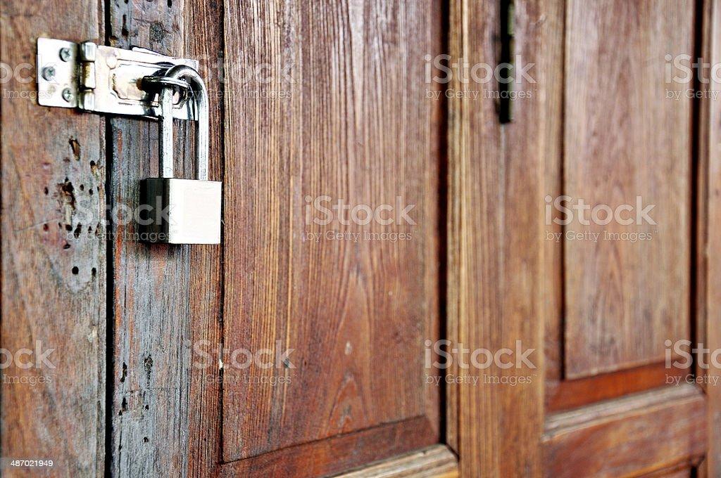 Locked wooden door royalty-free stock photo