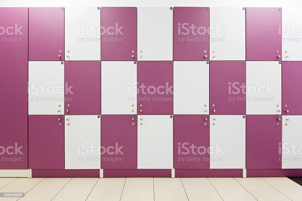Locker room with purple lockers stock photo
