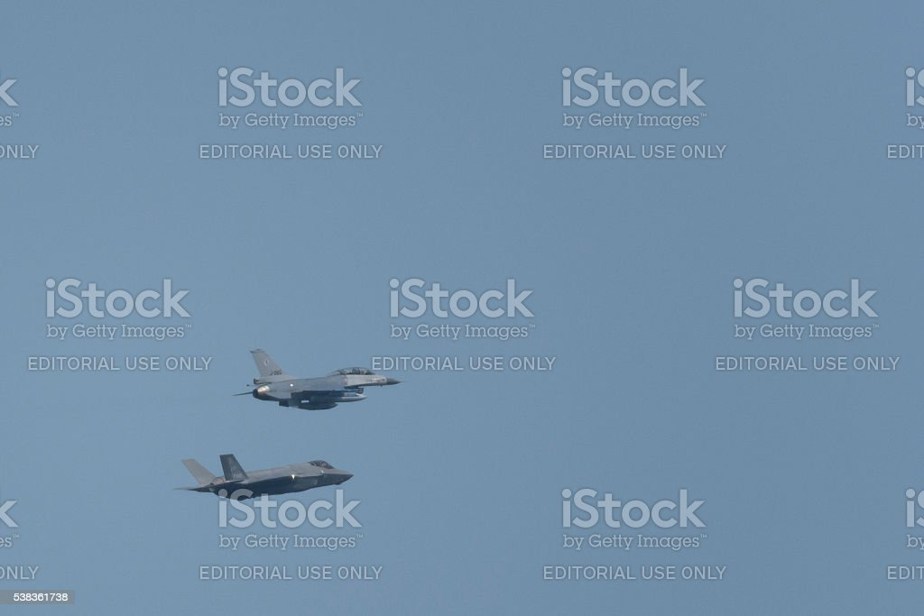 Lockheed Martin F-35 Joint Strike Fighter and F-16 Fighting Falc stock photo