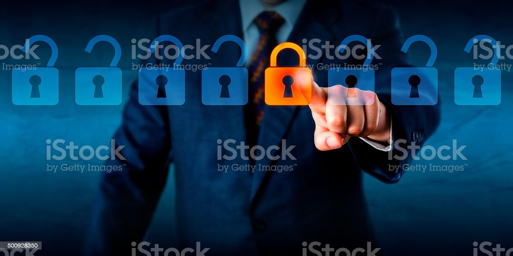 Locking A Virtual Lock In A Lineup Of Open Locks stock photo