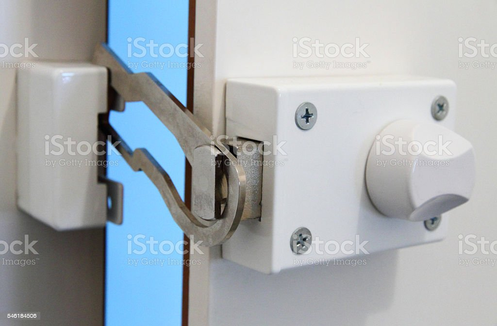 Locking bolt on a door stock photo