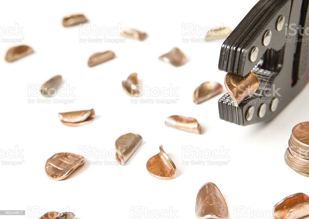 Locking Pliers Pinching and Bending a Penny stock photo