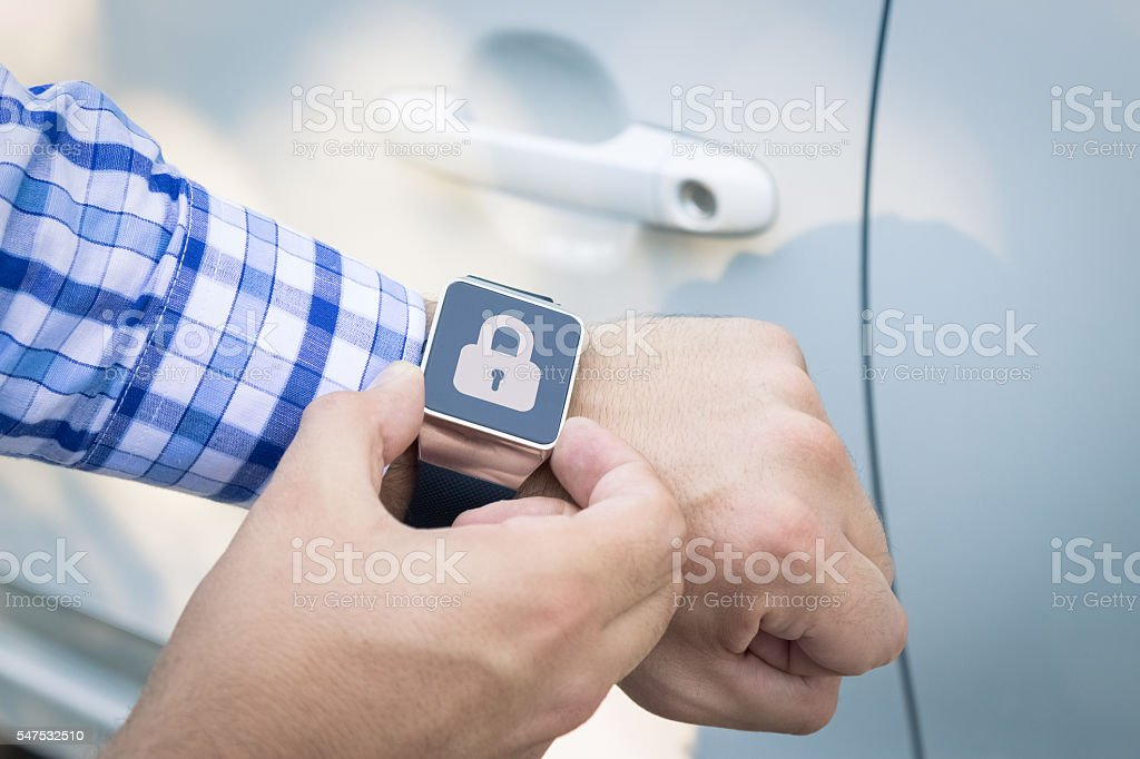 Locking the car with smart watch app stock photo