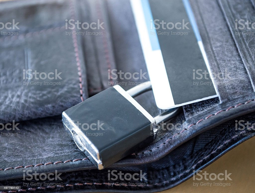 Lock/Padlock Locking/Securing a Credit/Debit Card in a Wallet Close Up royalty-free stock photo