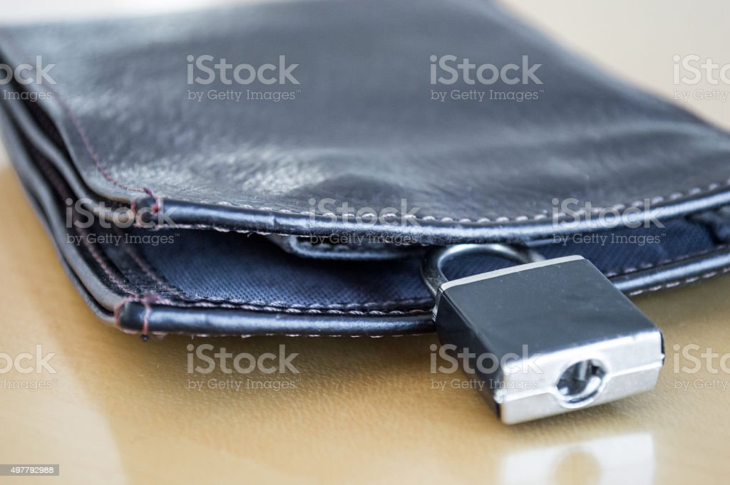 Lock/Padlock Locking/Securing a Leather Wallet Side View Close Up royalty-free stock photo