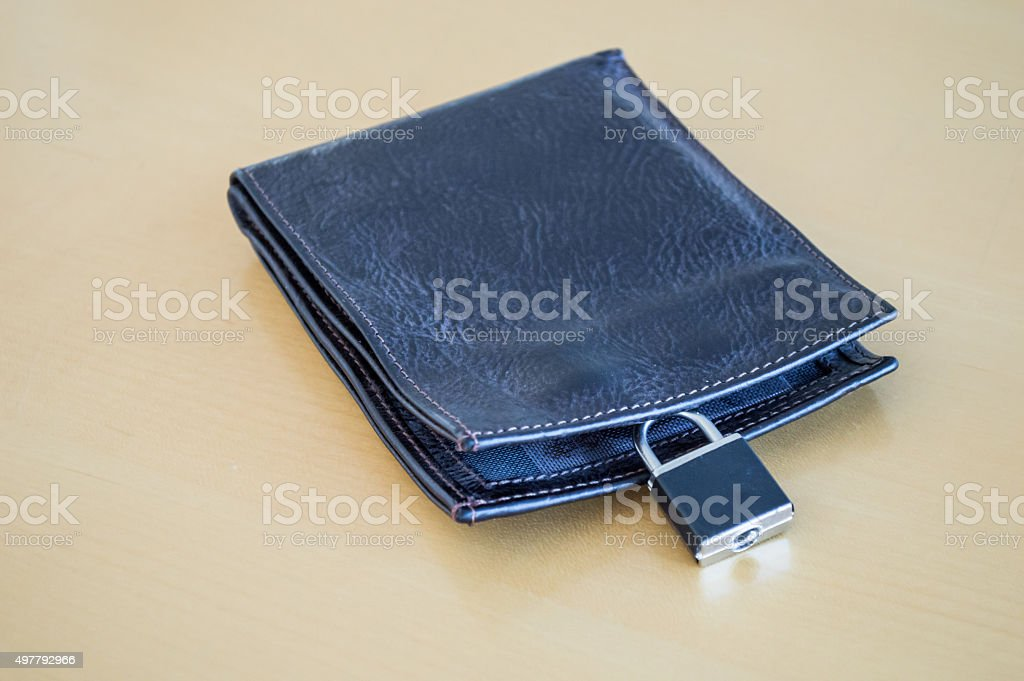 Lock/Padlock Locking/Securing a Leather Wallet Side View royalty-free stock photo