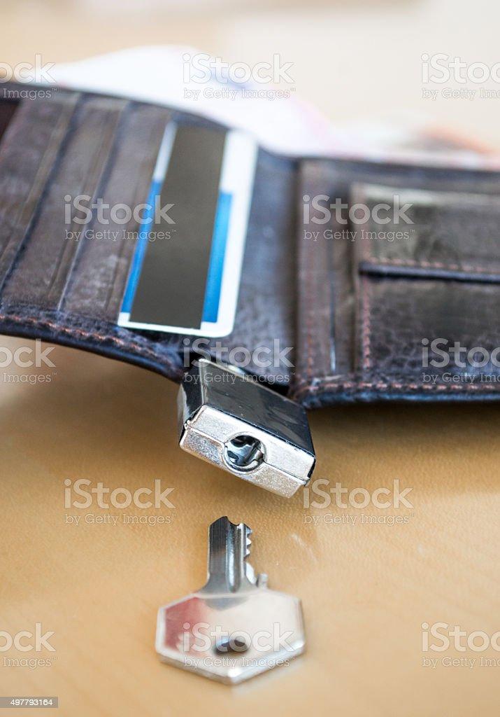 Lock/Padlock Locking/Securing a Wallet with Key Close Up royalty-free stock photo